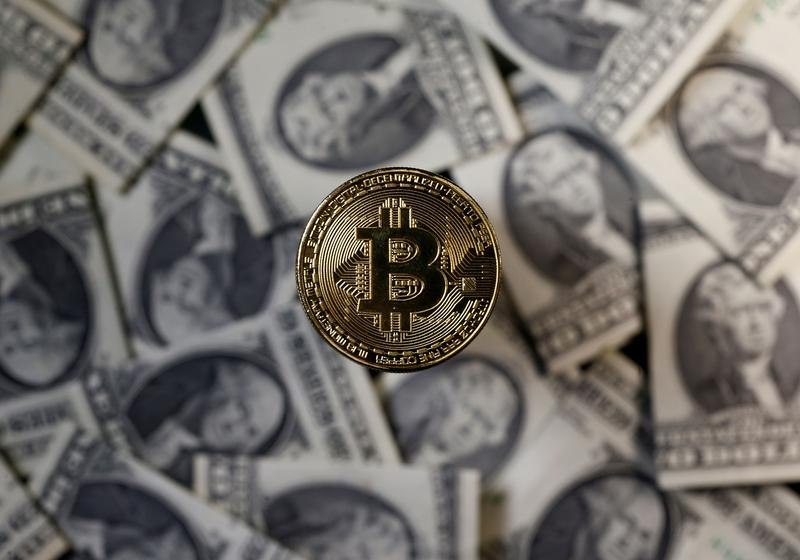 Bitcoin soars to new high above $52,000; sustainability concerns rise